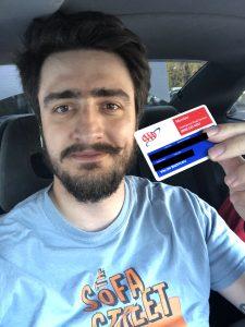 Holding AAA Membership Card